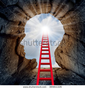stock-photo-concept-of-open-mind-as-a-a-deep-mountain-cliff-shaped-as-a-human-head-with-a-ladder-leading-to-the-385841326